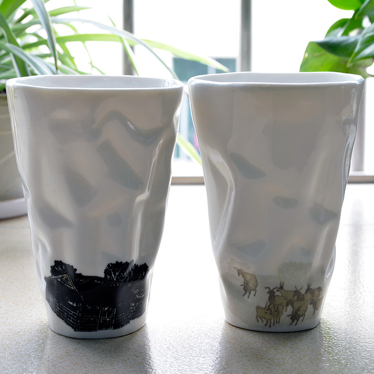 Shaped thermally altered ceramic cup